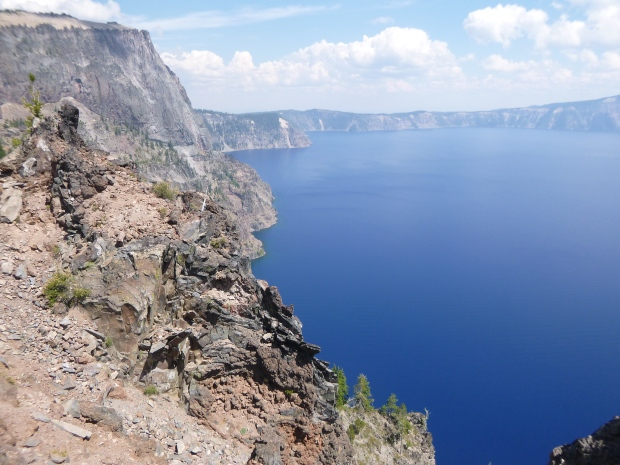 Lake with folded basalt embedded in rim, Crater Lake National Park, Oregon