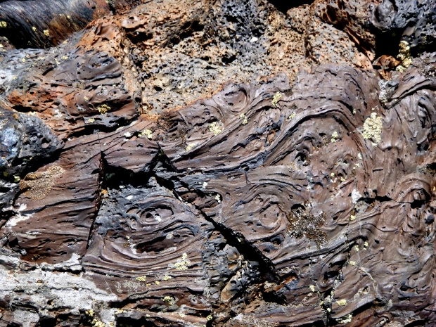 Awesome solidified lava patterns, North Crater Lava Flow, Craters of the Moon National Monument, Idaho.  Note that the reddish color is from oxidation.