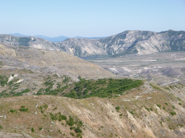 Creation of a barren landscape on nearby mountains from volcanic eruption, Mount St. Helens National Monument, WA
