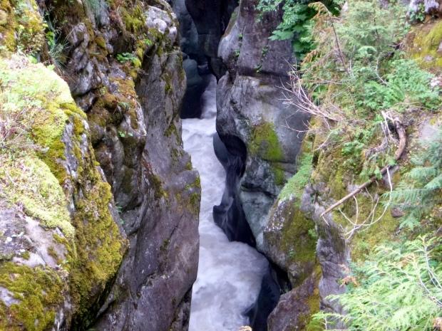 Close up view of water rushing through eroded volcanic rock, Box Canyon, Mount Rainier National Park, WA
