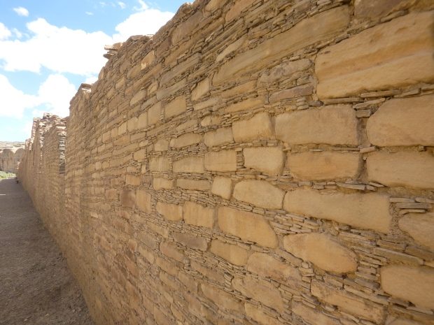 Back exterior wall of Chetro Ketl showing classic masonry chinking and extending 1,300 feet, ca. 1020 - 1120 AD, Chaco Canyon National Historical Park, New Mexico