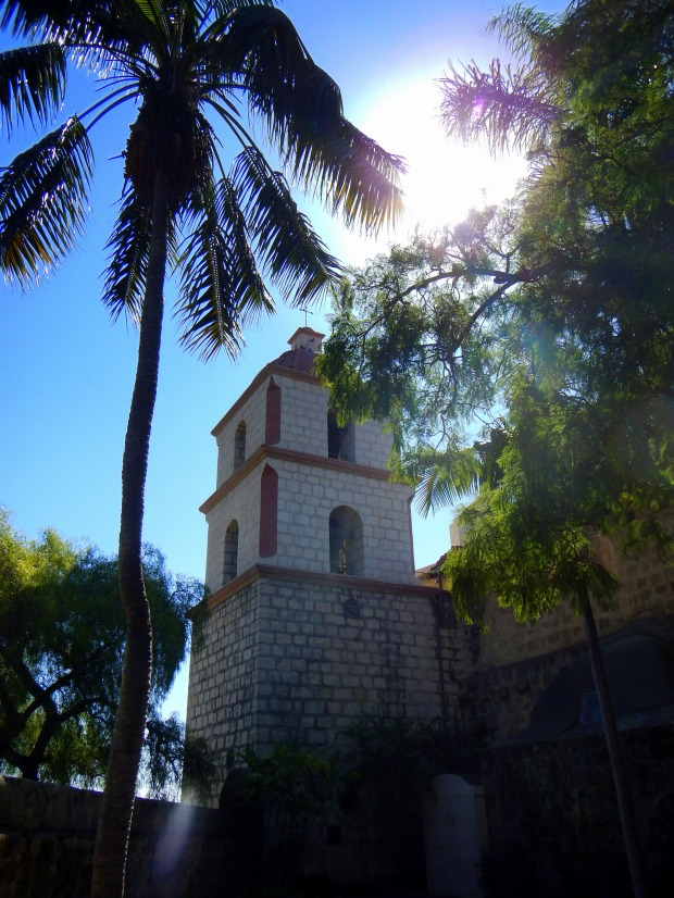 View of bell tower from within cemetery, Mission Santa Barbara, California