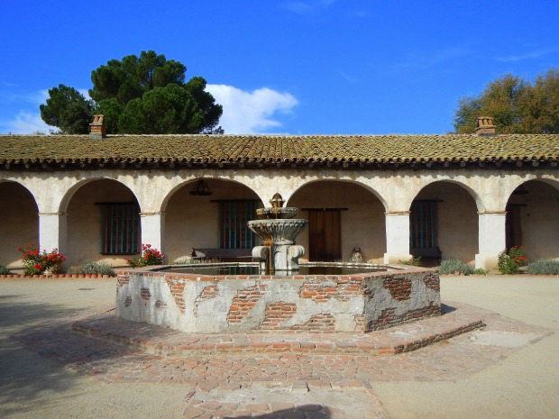 Courtyard with fountain facing arcade, Mission San Miguel Archangel, California