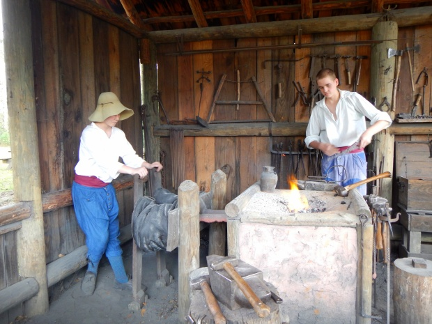 Operating the bellows and heating a knife, Blacksmith Shop, Mission San Luis de Apalachee, Tallahassee, Florida