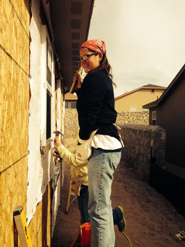 Celia's photo of me installing windows (I was clearly unprepared for this picture), Habitat for Humanity Build, Las Cruces, New Mexico