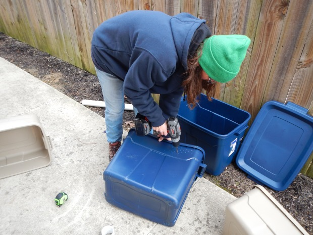 Me drilling air holes during the construction of worm bins for (worm castings) compost