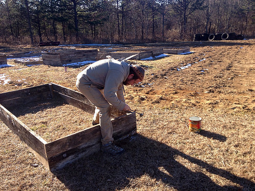 Jonathan hammering raised beds, Grundy County Community Garden, White City, Tennessee