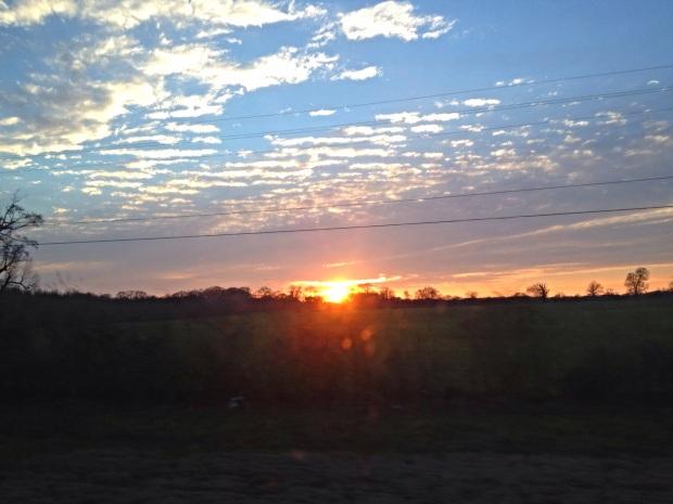 Vibrant sunset seen through the car window, Jackson, Louisiana