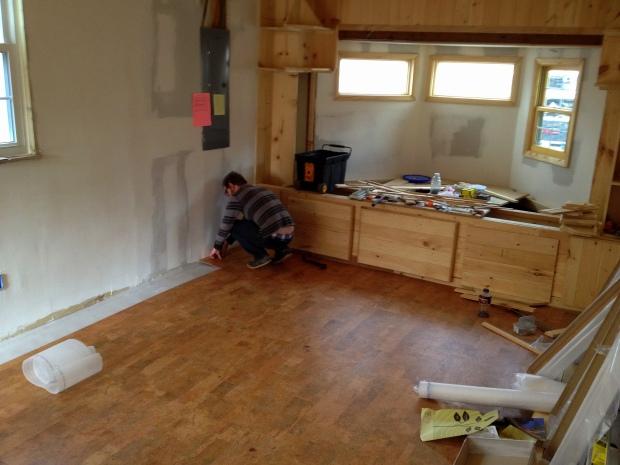 Intern Daniel installing flooring, Jasper, Tennessee