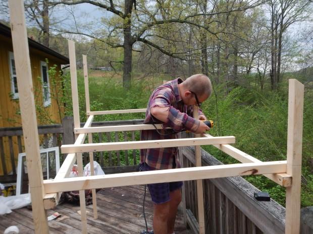 Daniel drilling the upright frame, Jasper, Tennessee