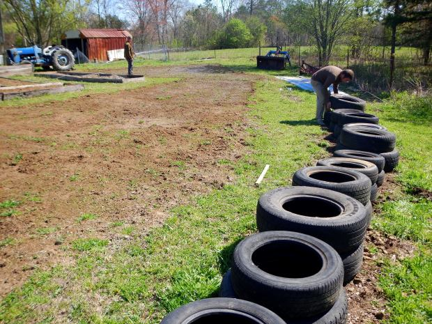 Jonathan and I lining up tires for the tire gardens, Grundy County Community Garden, White City, Tennessee