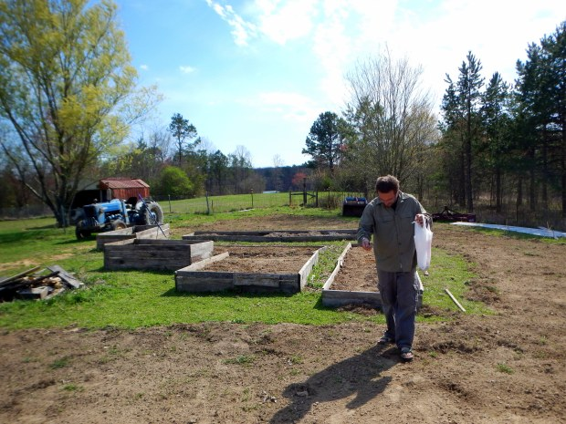 Jonathan broadcasting mustard seeds, Grundy County Community Garden, White City, Tennessee