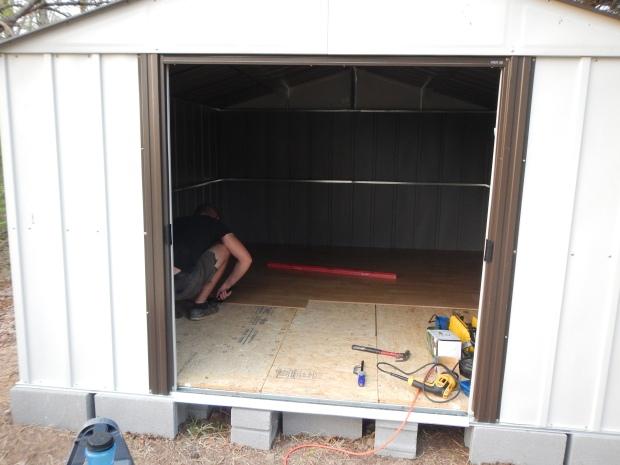 Daniel installing laminate flooring, Jasper, Tennessee