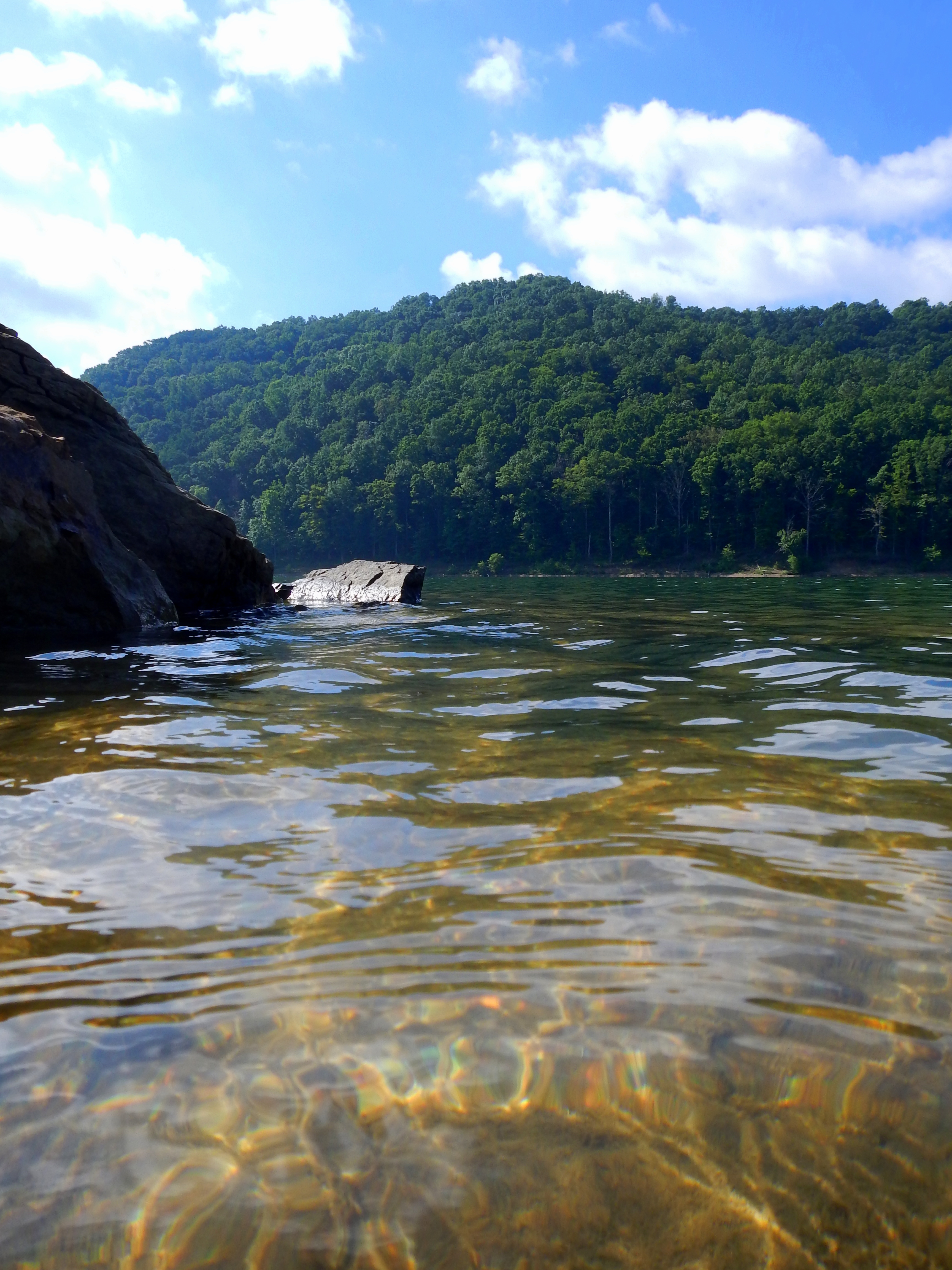 The clear waters of cave run lake near shallow flats daniel boone