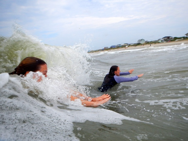Carrie and Chrissy body surfing, Oak Island, North Carolina