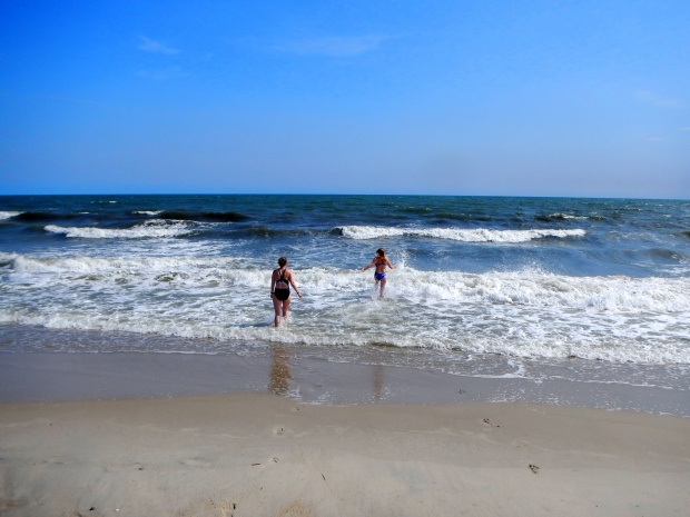 Carrie and Rachel running into water, Oak Island, North Carolina