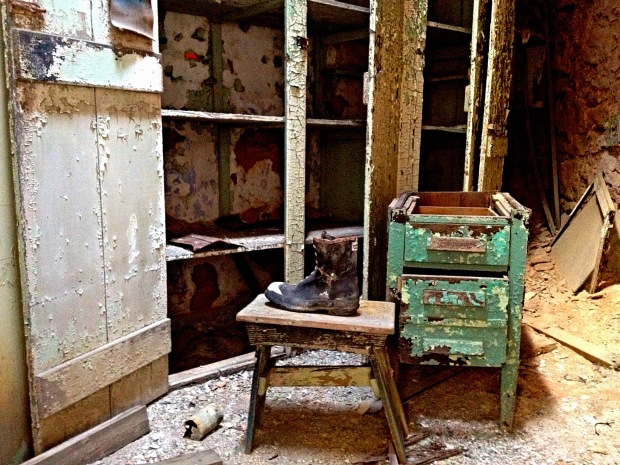 Discarded boot in a storeroom closet, Eastern State Penitentiary, Philadelphia, Pennsylvania