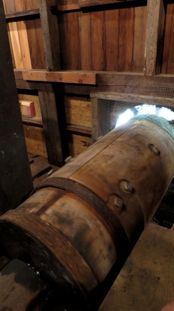 Spinning drive shaft connected to waterwheel, Old Town Mill, New London, Connecticut