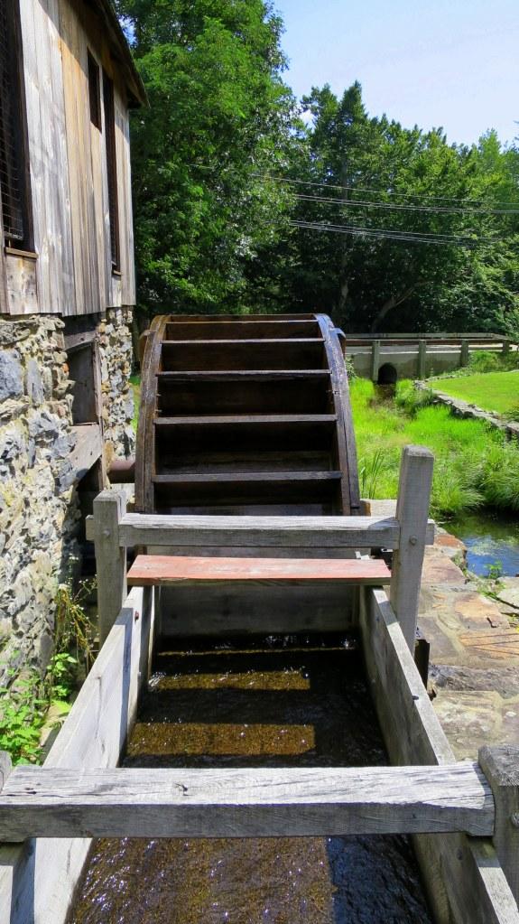Looking down raceway to 8,000 pound oak breastshot wheel of Hammond Mill, Gilbert Stuart Museum, Saunderstown, Rhode Island