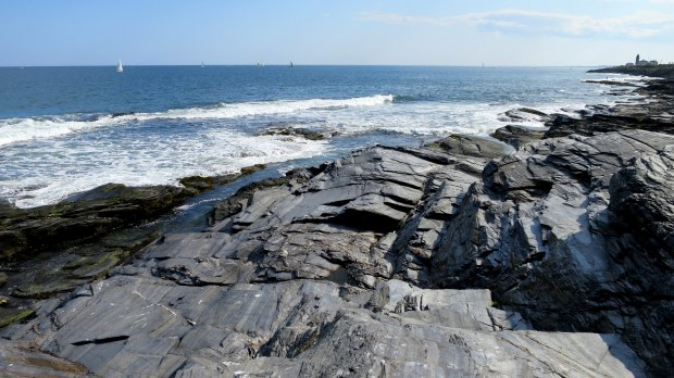 Rocks with Beavertail Lighthouse in background, Beavertail State Park, Jamestown, Rhode Island