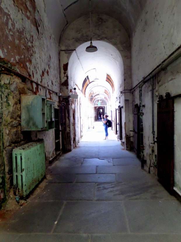 Tina standing ahead of me in cell block, Eastern State Penitentiary, Philadelphia, Pennsylvania
