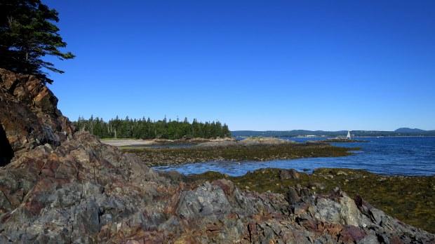 Climbing around the rocks near Owls Head Light Station, Owls Head, Maine