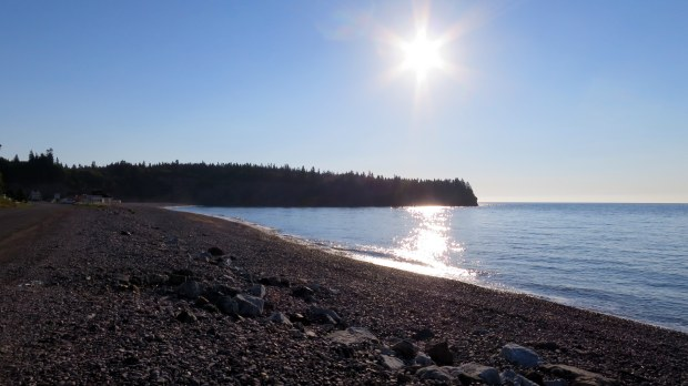 Passing the sea caves at high tide in the morning – I'm standing on the road for this photo, St. Martins Beach, St. Martins, New Brunswick, Canada