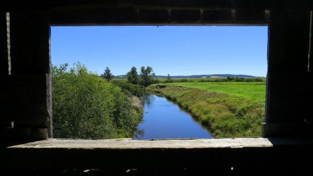 View from inside Sawmill Creek Covered Bridge, New Brunswick, Canada