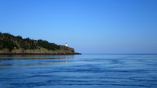 Boar's Head Lighthouse on Long Island seen from ferry while crossing Petit Passage, Nova Scotia, Canada