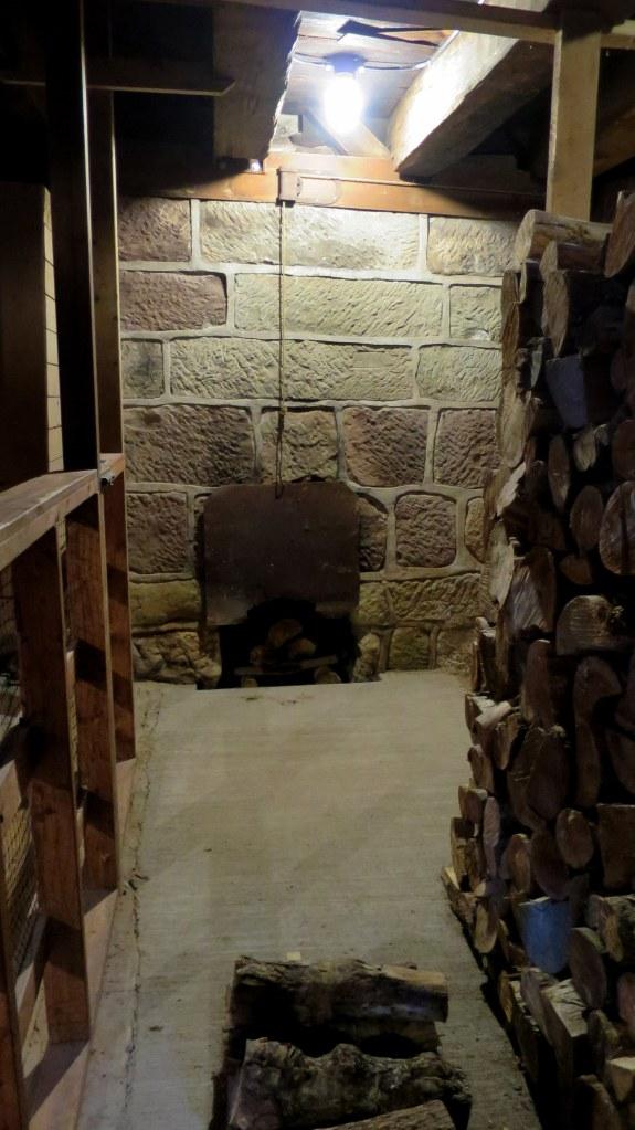 Furnace in basement under kiln floor on ground level, Balmoral Grist Mill, Nova Scotia, Canada