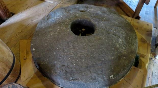 Closeup of granite grindstones, Balmoral Grist Mill, Nova Scotia, Canada