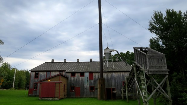 Back of Sutherland Steam Mill with hopper that would deposit framing lumber in wagons to be taken to the railroad, Denmark, Nova Scotia, Canada