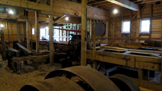 View of basement sawmill with gangsaw and rollers for planks visible, Sutherland Steam Mill Museum, Denmark, Nova Scotia, Canada