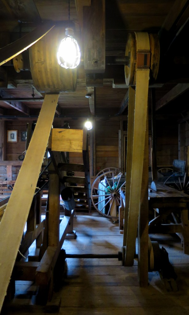 View of main and a secondary belt as well as drive shafts on ground floor, Sutherland Steam Mill Museum, Denmark, Nova Scotia, Canada