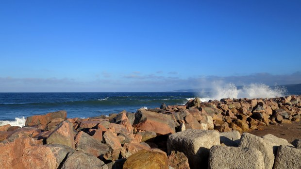 Waves crashing on the breakwater at Dingwall Harbor, Cape Breton Island, Nova Scotia, Canada
