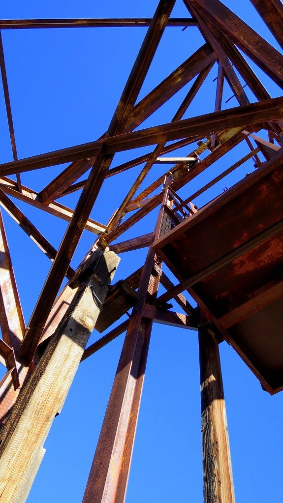 Standing on the grated mine shaft looking up at the mine elevator infrastructure, Silver Reef, Utah
