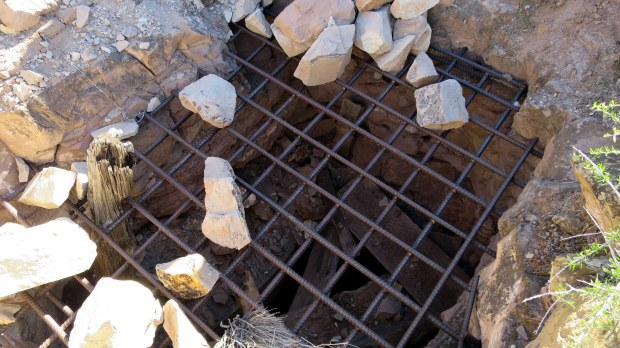 One of the many now-grated small mine shafts, Silver Reef, Utah
