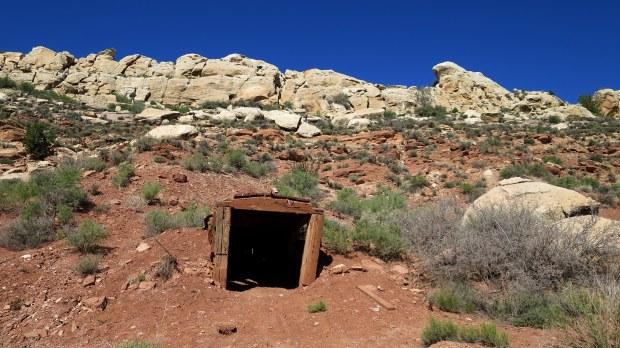 Old mine entrance in hillside, Silver Reef, Utah