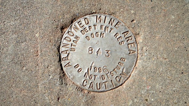 Embedded in concrete of grated and sealed mine shaft of 540 ft, Silver Reef, Utah