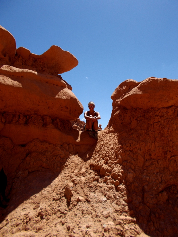 Me sitting between goblins, Goblin Valley State Park, Utah