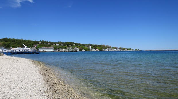Shore of Mackinac Island with town in background, Michigan