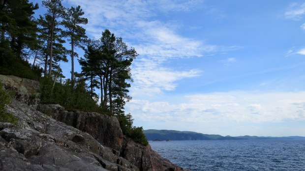 Climbing the basalt headlands, Lake Superior Provincial Park, Ontario, Canada