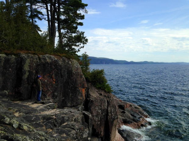 Me looking into a fracture in the headland rock, Lake Superior Provincial Park, Ontario, Canada