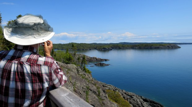 Tom taking pictures from a viewing deck on the Manito Miikana Trail, Pukaskwa National Park, Ontario, Canada