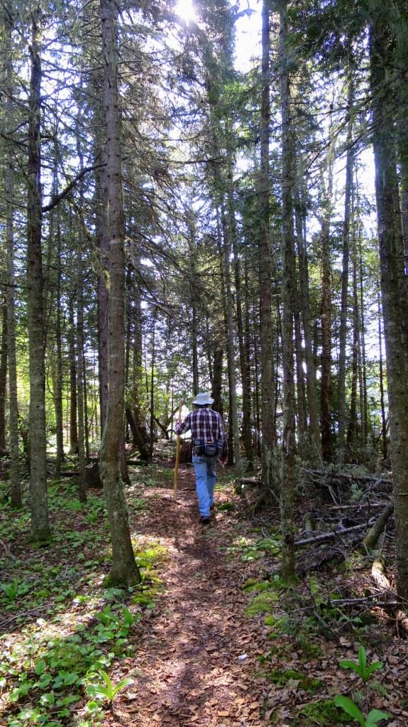 Tom hiking ahead of me on Coastal Trail, Pukaskwa National Park, Ontario, Canada