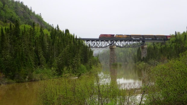 Canadian Pacific train crossing the Little Pic River, Neys Provincial Park, Ontario, Canada