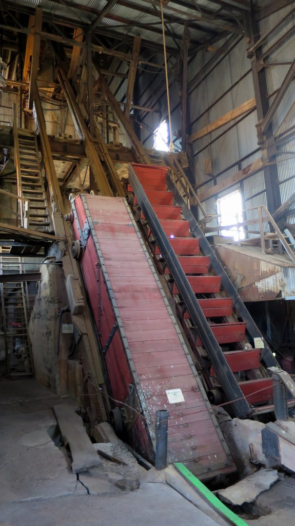 Interior of 1882 Hoist House with miner transport skip on right and water scoop on left, Quincy Mine Hoist, Hancock, Michigan