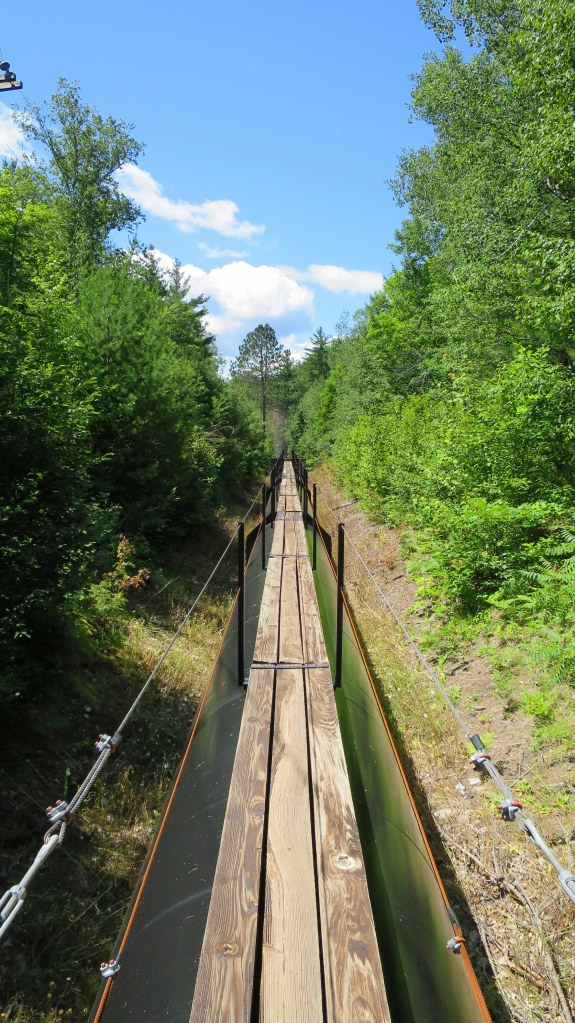 Walking the gangway above the pipeline, Saxon Falls Hydro Plant, Michigan