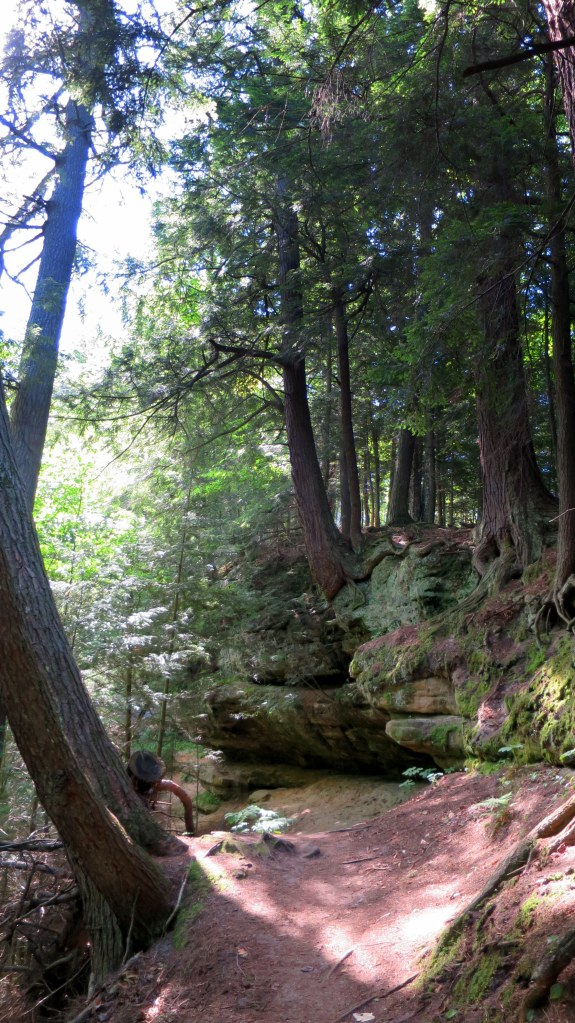 Sun and shade dotting the trees and rock on the trail to Memorial Falls, Munising, Michigan