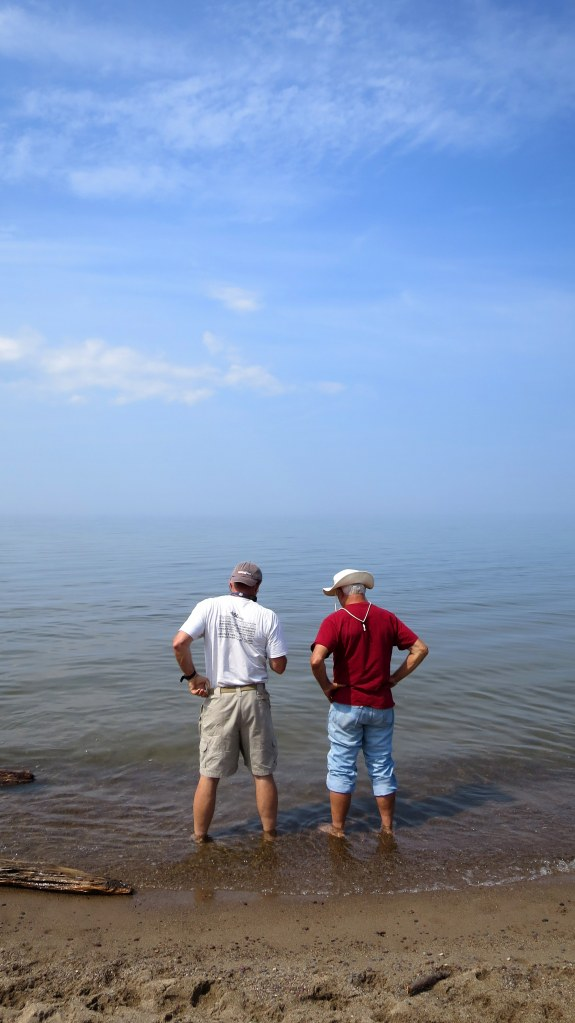 Grey and Tom standing in Lake Superior near Silver City, Michigan